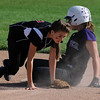 Emilie Burus, right,  of Boulder High  slides into second safe as the ball gets away from K.J. Hodgson of Fairview High School.<br /> Cliff Grassmick / September 17, 2009
