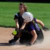Emilie Burus of Boulder High  slides into second safe as the ball gets away from K.J. Hodgson of Fairview High School.<br /> Cliff Grassmick / September 17, 2009