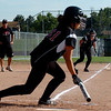 Daria Caraway  of Fairview puts down a bunt that scores Grace Modisett, background.<br /> Cliff Grassmick / September 17, 2009