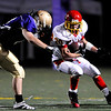 """Boulder High's Andrew Wishner (8) side tackles Northglenn's  Eric Balich (20) during the game at Recht Field in Boulder, Sept. 11, 2009.<br /> <br /> For more photos please visit  <a href=""""http://www.dailycamera.com"""">http://www.dailycamera.com</a><br /> <br />  DAILY CAMERA/Kasia Broussalian"""