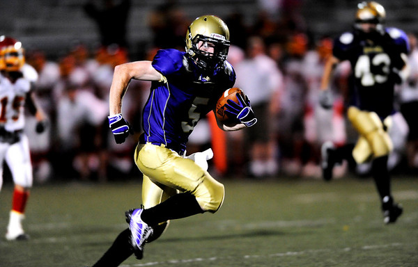 """Boulder High's  Blake Gouin (5) runs the ball down field during the game against Northglenn at Recht Field in Boulder, Sept. 11, 2009.<br /> <br /> For more photos please visit  <a href=""""http://www.dailycamera.com"""">http://www.dailycamera.com</a><br /> <br />  DAILY CAMERA/Kasia Broussalian"""