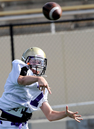 Boulder High quarterback Blake Partridge throws a pass during practice at Recht Field in Boulder, Colorado August 19, 2009. CAMERA/Mark Leffingwell