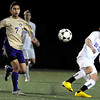 Boulder High School senior Will Maxwell kicks the ball past Fort Collins sophomore Jairo Cerna on Thursday, Oct. 14, during a soccer match against Fort Collins at Recht Field in Boulder.  The final score was 2-2 after two overtimes.<br /> Jeremy Papasso/ Camera