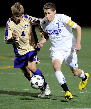 Boulder High School senior Will Maxwell moves the ball past Fort Collins junior Dalton Murphree on Thursday, Oct. 14, during a soccer match against Fort Collins at Recht Field in Boulder.  The final score was 2-2 after two overtimes.<br /> Jeremy Papasso/ Camera