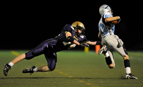 "Boulder High School sophomore Philip Swisher misses a tackle on Ralston Valley senior Nate Grigsby on during the football game against Ralston Valley High School on Friday, Oct. 1, at Boulder High School.Ralston Valley defeated Boulder 38-0.<br /> For photo gallery go to  <a href=""http://www.dailycamera.com"">http://www.dailycamera.com</a><br /> Jeremy Papasso/ Camera"
