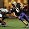 "Boulder High School senior Ethan Baker shakes a tackle from Ralston Valley sophomore Cameron Sawano during the football game against Ralston Valley High School on Friday, Oct. 1, at Boulder High School. Ralston Valley defeated Boulder 38-0.<br /> For photo gallery go to  <a href=""http://www.dailycamera.com"">http://www.dailycamera.com</a><br /> Jeremy Papasso/ Camera"