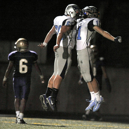 "Ralston Valley players Ryann Derrick, right, and Dillon Young celebrate while Boulder senior Lucas Granillo walks towards the sideline after Derrick scored a touchdown in the third quarter of the football game on Friday, Oct. 1, at Boulder High School. Ralston Valley defeated Boulder 38-0.<br /> For photo gallery go to  <a href=""http://www.dailycamera.com"">http://www.dailycamera.com</a><br /> Jeremy Papasso/ Camera"