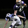 "Boulder High School senior Jordan Sloat shakes a tackle from Ralston Valley senior Nate Grisgsby during the football game against Ralston Valley High School on Friday, Oct. 1, at Boulder High School. Ralston Valley defeated Boulder 38-0.<br /> For photo gallery go to  <a href=""http://www.dailycamera.com"">http://www.dailycamera.com</a><br /> Jeremy Papasso/ Camera"