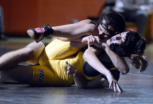 "Fairview High School's George Martinez tries to pin Nina Gustafson by during a 113 lb. wrestling match against Boulder High School on Thursday, Dec. 6, at Fairview. Martinez won the match. For more photos of the match go to  <a href=""http://www.dailycamera.com"">http://www.dailycamera.com</a><br /> Jeremy Papasso/ Camera"