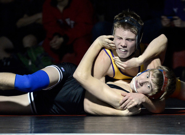 """Boulder High School's Zenobe Romijn works to pin Aaron pobywajlo during a 126 lb. wrestling match against Fairview High School on Thursday, Dec. 6, at Fairview. Romijn won the match. For more photos of the match go to  <a href=""""http://www.dailycamera.com"""">http://www.dailycamera.com</a><br /> Jeremy Papasso/ Camera"""