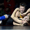 "Boulder High School's Zenobe Romijn works to pin Aaron pobywajlo during a 126 lb. wrestling match against Fairview High School on Thursday, Dec. 6, at Fairview. Romijn won the match. For more photos of the match go to  <a href=""http://www.dailycamera.com"">http://www.dailycamera.com</a><br /> Jeremy Papasso/ Camera"