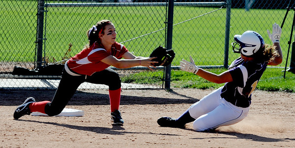 "Riana Galbiati of Boulder High, slides into a tag at third by Hannah Sheridan of Fairview.<br /> For more photos of the game, go to  <a href=""http://www.dailycamera.com"">http://www.dailycamera.com</a>.<br /> Cliff Grassmick / September 24, 2011"