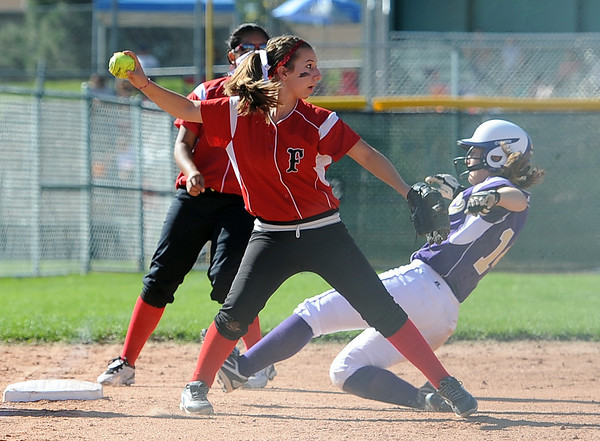 "Hannah Sheridan of Fairview, gets the out at third on Isabelle Davij of Boulder High.<br /> For more photos of the game, go to  <a href=""http://www.dailycamera.com"">http://www.dailycamera.com</a>.<br /> Cliff Grassmick / September 24, 2011"