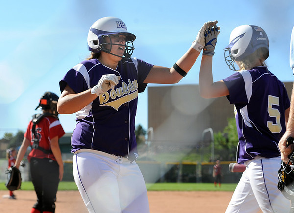 "Erin Corkill, left, of Boulder High, gets a high five from Natalie Platt, after scoring the Panthers' first run.<br /> For more photos of the game, go to  <a href=""http://www.dailycamera.com"">http://www.dailycamera.com</a>.<br /> Cliff Grassmick / September 24, 2011"