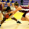BLDRHOR01<br /> Boulder's Ashley Kennedy fights for the ball against Kaylie Rader of Horizon.<br /> Photo by Marty Caivano/Camera/Jan. 15, 2010