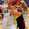 BLDRHOR02<br /> Boulder's Emilie Burns struggles for possession against Kaylie Rader of Horizon.<br /> Photo by Marty Caivano/Camera/Jan. 15, 2010