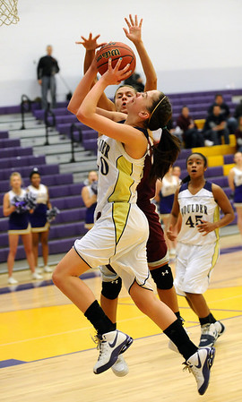 BLDRHOR05<br /> Boulder's Lizzie Hickey shoots while under pressure from Rachel Bollinger of Horizon.<br /> Photo by Marty Caivano/Camera/Jan. 15, 2010