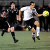 Boulder's Spencer Sarson (right) advances the ball down field while being pressured by Rocky Mountain's Picardo Perez (left) during their soccer game at Recht Field in, Colorado October 13, 2009.  CAMERA/Mark Leffingwell (UNITED STATES)