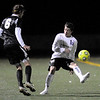 Boulder's William Husted (right) kicks the ball away from Rocky Mountain's Ross Williams (left) during their soccer game at Recht Field in, Colorado October 13, 2009.  CAMERA/Mark Leffingwell (UNITED STATES)