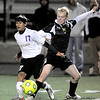 Boulder's Rojesh Shrestha (left) and Rocky Mountain's Cody Borer (right) go for the ball during their soccer game at Recht Field in, Colorado October 13, 2009.  CAMERA/Mark Leffingwell (UNITED STATES)
