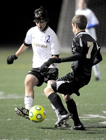 Boulder's Avery Bills (left) kicks the ball from Rocky Mountain's Chet Mogorit (right) during their soccer game at Recht Field in, Colorado October 13, 2009.  CAMERA/Mark Leffingwell (UNITED STATES)