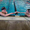 Fairview freshman Abbie Houck (left) shakes hand with freshman teammate Lacey Smith after finishing the last heat of the 200 Yard Freestyle race during the Boulder County Invitational at the South Boulder Recreation Center in Boulder, Saturday, Jan. 23, 2009. <br /> KASIA BROUSSALIAN