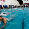 Fairview senior Lauren Rigg (right) jumps off the blocks as freshman teammate Janaye Monica comes in off the 200 Medley Relay during the Boulder County Invitational at the South Boulder Recreation Center in Boulder, Saturday, Jan. 23, 2009. <br /> KASIA BROUSSALIAN