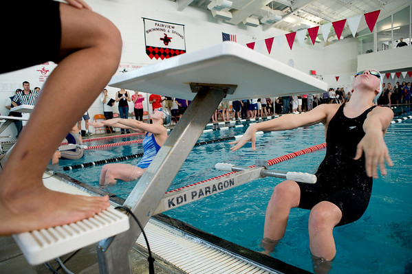 Fairview junior Caroline Patterson jumps off the blocks for the start of the 200 Yard Medley Relay during the Boulder County Invitational at the South Boulder Recreation Center in Boulder, Saturday, Jan. 23, 2009. <br /> KASIA BROUSSALIAN