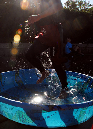 """One of the Boulder Peak triathletes washes their feet in the pool after coming off the sand.<br /> For more photos  and video of the Boulder Peak, go to  <a href=""""http://www.dailycamera.com"""">http://www.dailycamera.com</a><br />  Cliff Grassmick / July 11, 2010"""