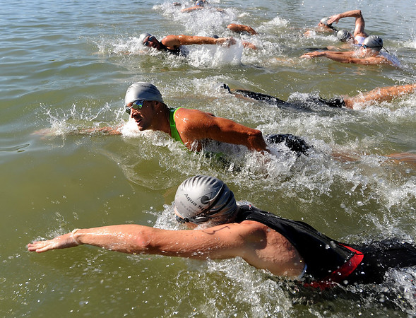 """The professional men begin the Boulder Peak Triathlon in Boulder Reservoir on Sunday. Tim O'Donnell was the eventual winner.<br /> For more photos  and video of the Boulder Peak, go to  <a href=""""http://www.dailycamera.com"""">http://www.dailycamera.com</a><br />  Cliff Grassmick / July 11, 2010"""