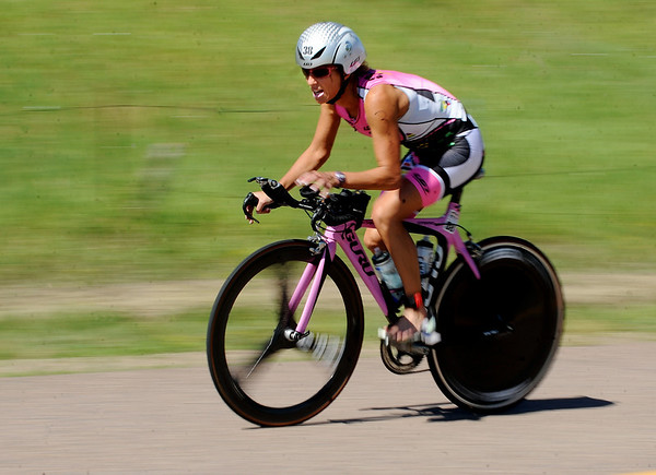 """Joanna Zieger was the first pro to come off the bike in the Boulder Peak Triathlon on Sunday. Zeiger was the first female finisher.<br /> For more photos  and video of the Boulder Peak, go to  <a href=""""http://www.dailycamera.com"""">http://www.dailycamera.com</a><br />  Cliff Grassmick / July 11, 2010"""