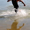 """Bryan Rhodes was the first pro man to come out of the water during the Boulder Peak Triathlon on Sunday.<br /> For more photos  and video of the Boulder Peak, go to  <a href=""""http://www.dailycamera.com"""">http://www.dailycamera.com</a><br />  Cliff Grassmick / July 11, 2010"""