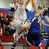 """Riley Grabau (22) of Boulder High,  shoots over  a Rampart player.<br /> For more photos of the game. go to  <a href=""""http://www.dailycamera.com"""">http://www.dailycamera.com</a>.<br /> Cliff Grassmick / December 11, 2010"""