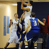 """Chris Zeren of Boulder High, gets a rebound against Rampart.<br /> For more photos of the game. go to  <a href=""""http://www.dailycamera.com"""">http://www.dailycamera.com</a>.<br /> Cliff Grassmick / December 11, 2010"""