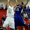"Zach Wilson of Boulder High, drives into Jared Theis of Rampart.<br /> For more photos of the game. go to  <a href=""http://www.dailycamera.com"">http://www.dailycamera.com</a>.<br /> Cliff Grassmick / December 11, 2010"