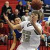 """Riley Grabau (22) of Boulder High, gets control of the ball  to shoot past  Matt Hower of Rampart.<br /> For more photos of the game. go to  <a href=""""http://www.dailycamera.com"""">http://www.dailycamera.com</a>.<br /> Cliff Grassmick / December 11, 2010"""