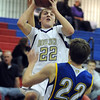 """Riley Grabau (22) of Boulder High, shoots over  Max Cook of Rampart.<br /> For more photos of the game. go to  <a href=""""http://www.dailycamera.com"""">http://www.dailycamera.com</a>.<br /> Cliff Grassmick / December 11, 2010"""