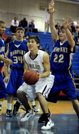 Chris Zeren of Boulder High, shoots under Max Cook of Rampart.<br /> Cliff Grassmick / December 11, 2010