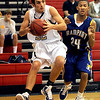 "Zach Wilson of Boulder High, drives past  Donte Monroe of Rampart.<br /> For more photos of the game. go to  <a href=""http://www.dailycamera.com"">http://www.dailycamera.com</a>.<br /> Cliff Grassmick / December 11, 2010"
