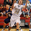 "Riley Grabau (22) of Boulder High, gets control of the ball  to shoot past  Matt Hower of Rampart.<br /> For more photos of the game. go to  <a href=""http://www.dailycamera.com"">http://www.dailycamera.com</a>.<br /> Cliff Grassmick / December 11, 2010"