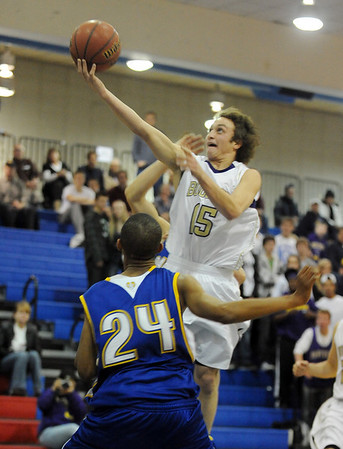"""Marc Krimstock of Boulder High, scores on Donte Monroe (24) of Rampart.<br /> For more photos of the game. go to  <a href=""""http://www.dailycamera.com"""">http://www.dailycamera.com</a>.<br /> Cliff Grassmick / December 11, 2010"""