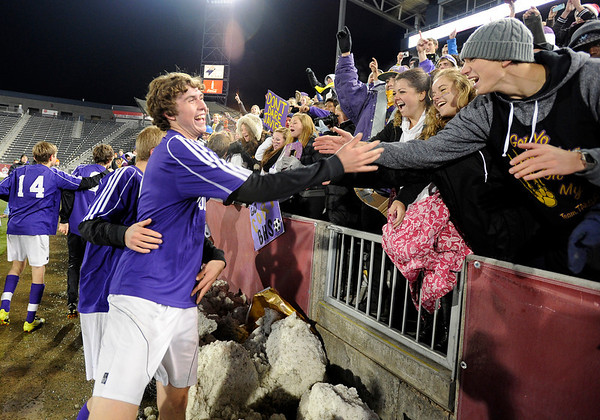 Boulder High School's Cory Waltrip gets high-fives from fans at the end of the boys Class 5A State Championship against Smoky Hill High School on Monday, Nov. 12, at Dick's Sporting Goods Park in Commerce City. Boulder won the game 3-1.<br /> Jeremy Papasso/ Camera
