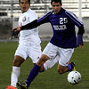 Boulder High School's Pancho Valdivieso moves the ball past Daniel Becerra during the boys Class 5A State Championship against Smoky Hill High School on Monday, Nov. 12, at Dick's Sporting Goods Park in Commerce City. Boulder won the game 3-1.<br /> Jeremy Papasso/ Camera