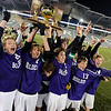 Boulder High School's Lake Brant, No. 21, Kevin Van Lieshout, No. 2, Finnian Bunta, No. 13, Wyeth Leemon, No. 14, and the rest of the team cheer as they hold the championship trophy after winning the boys Class 5A State Championship against Smoky Hill High School on Monday, Nov. 12, at Dick's Sporting Goods Park in Commerce City. Boulder won the game 3-1.<br /> Jeremy Papasso/ Camera