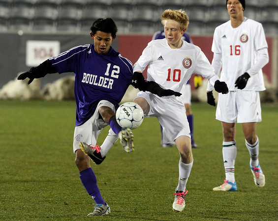 Boulder High School's Sushant Gurung fights for the ball with Tyler Glenn during the boys Class 5A State Championship against Smoky Hill High School on Monday, Nov. 12, at Dick's Sporting Goods Park in Commerce City. Boulder won the game 3-1.<br /> Jeremy Papasso/ Camera