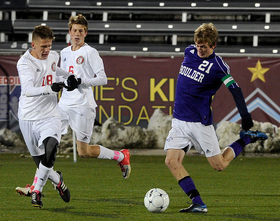 Boulder High School's Lake Brant takes a shot on goal past Kevin Edgar during the boys Class 5A State Championship against Smoky Hill High School on Monday, Nov. 12, at Dick's Sporting Goods Park in Commerce City. Boulder won the game 3-1.<br /> Jeremy Papasso/ Camera