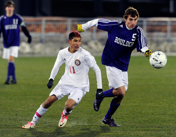Boulder High School's Mason Douillard fights for the ball with Kevin Del Mazo during the boys Class 5A State Championship against Smoky Hill High School on Monday, Nov. 12, at Dick's Sporting Goods Park in Commerce City. Boulder won the game 3-1.<br /> Jeremy Papasso/ Camera