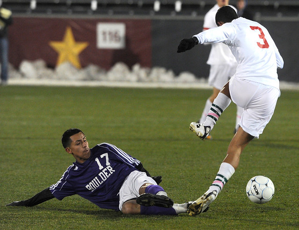 Boulder High School's Luis Castrulta slide tackles James Grinage during the boys Class 5A State Championship against Smoky Hill High School on Monday, Nov. 12, at Dick's Sporting Goods Park in Commerce City. Boulder won the game 3-1.<br /> Jeremy Papasso/ Camera