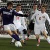 Boulder High School's Matteo Wilczak tries to get to the goal past Colton Ladyga, No. 6, and Kevin Edgar, No. 18, during the boys Class 5A State Championship against Smoky Hill High School on Monday, Nov. 12, at Dick's Sporting Goods Park in Commerce City. Boulder won the game 3-1.<br /> Jeremy Papasso/ Camera