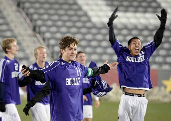 Boulder High School's Cory Waltrip, center, and Luis Castrulta, right, celebrate after winning the boys Class 5A State Championship against Smoky Hill High School on Monday, Nov. 12, at Dick's Sporting Goods Park in Commerce City. Boulder won the game 3-1.<br /> Jeremy Papasso/ Camera